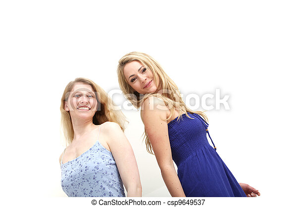 Two smiling woman on white background - csp9649537