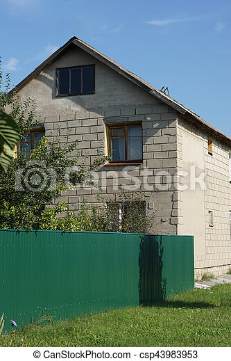 Two Storey House With A Green Fence Two Storey House Behind The
