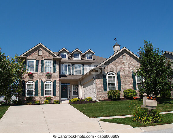 Two Story Brick Home with Window Bo - csp6006609