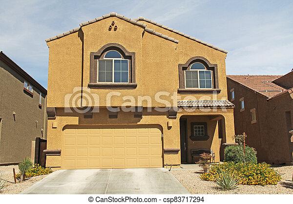 Two-story Stucco Home in Tucson, Arizona - csp83717294
