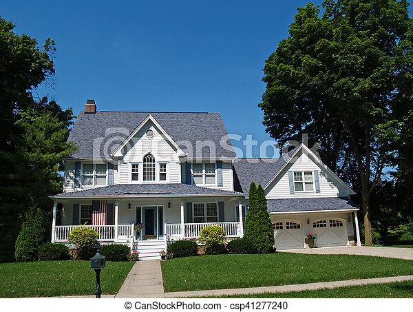 Two-story White Home with Garage - csp41277240