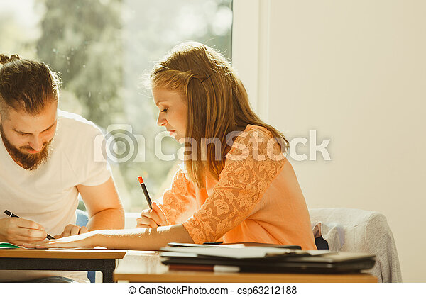 Two students in class - csp63212188