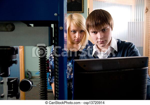 Two students in front of the monitor in the workshops - csp13720914