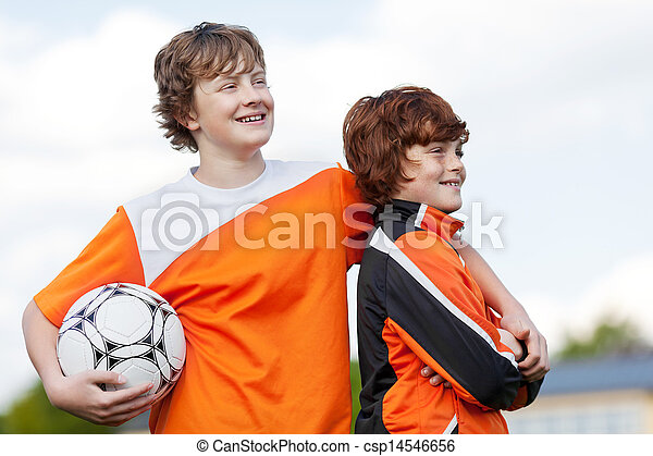 two team mates at soccer training - csp14546656