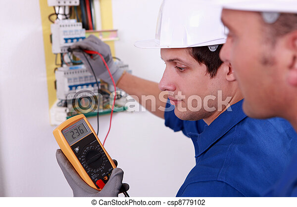 Two technical engineers checking electrical equipment - csp8779102
