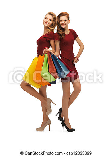 two teenage girls with shopping bags - csp12033399