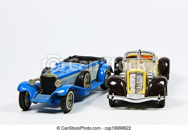 Two Toy Vintage Model Cars on White - csp19999622