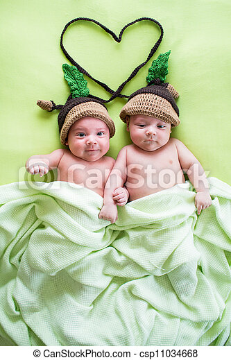 two twins brothers babies weared in acorn hats - csp11034668