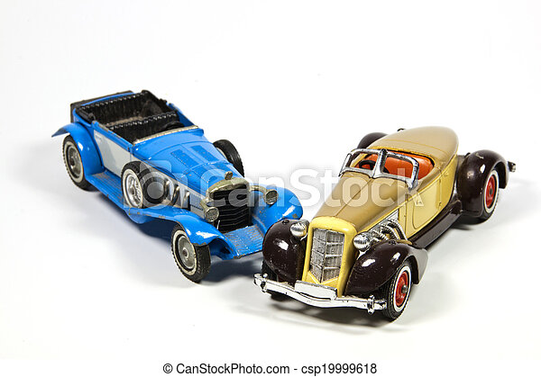 Two Vintage Toy Model Cars on White - csp19999618