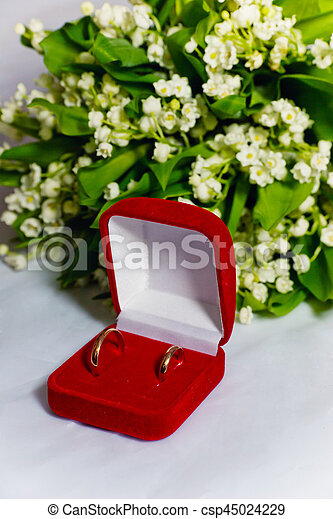 Two wedding rings and  lilies of the valley - csp45024229
