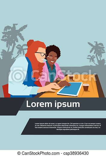 Two Woman Using Tablet Sit In Cafe - csp38936430