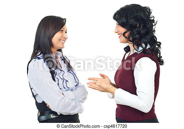 Two women having happy conversation - csp4617720