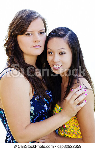 Two Women In Dresses Outdoors Asian American And Caucasian - csp32922659