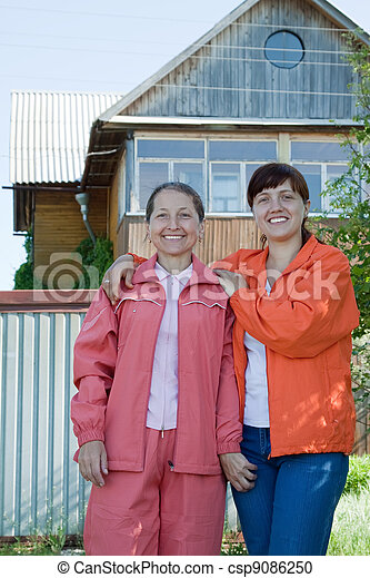 Two  women  in front of  home - csp9086250