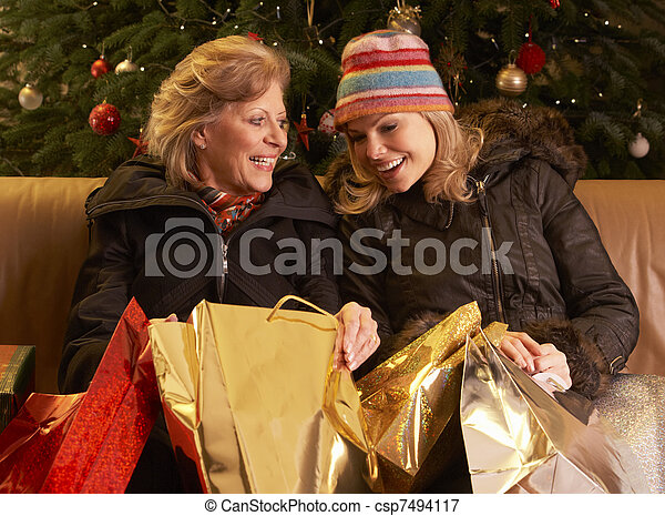 Two Women Returning After Christmas Shopping Trip - csp7494117