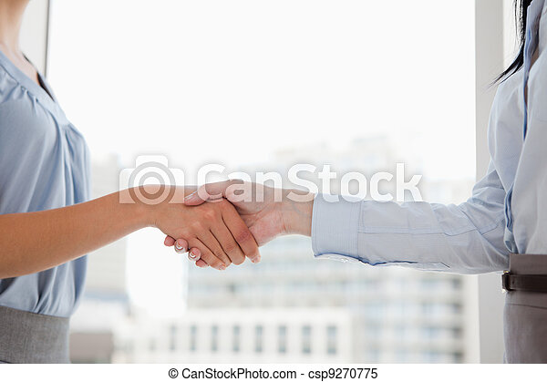 Two women shaking hands in the office - csp9270775
