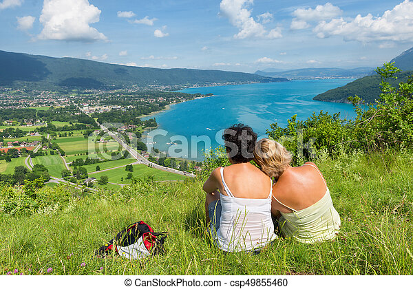 Two women watching view of Lake Annecy - csp49855460