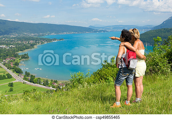 Two women watching view of Lake Annecy - csp49855465