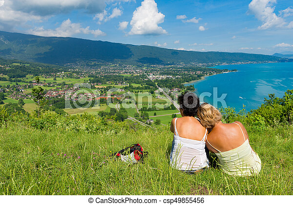 Two women watching view of Lake Annecy - csp49855456