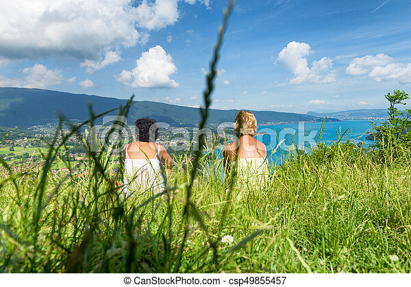 Two women watching view of Lake Annecy - csp49855457