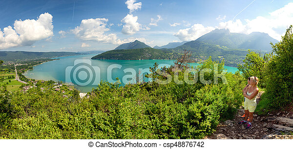 Two women watching view of Lake Annecy - csp48876742