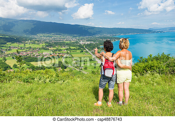 Two women watching view of Lake Annecy - csp48876743