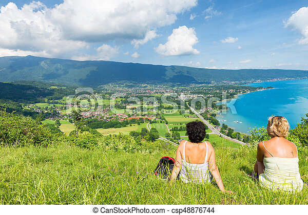 Two women watching view of Lake Annecy - csp48876744