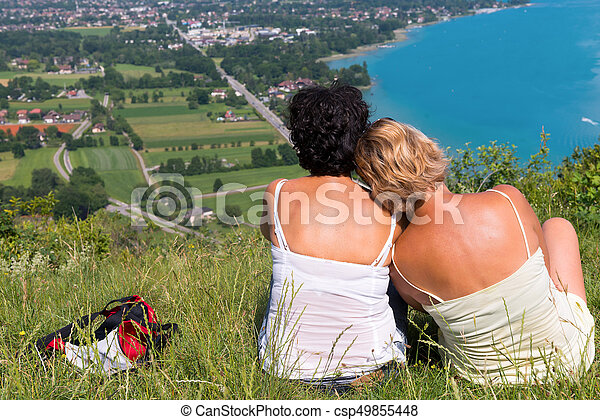 Two women watching view of Lake Annecy - csp49855448