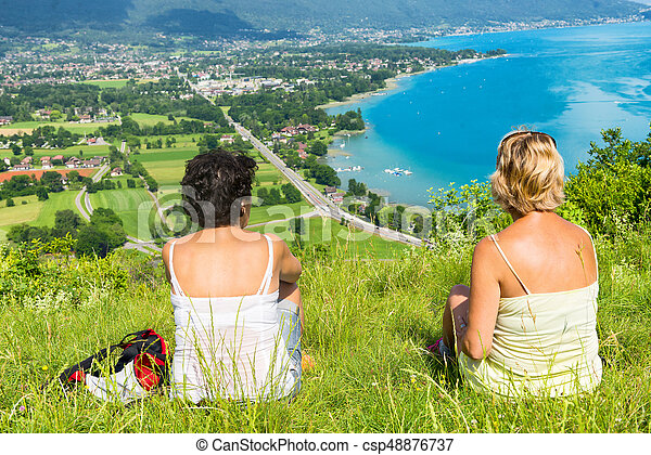 Two women watching view of Lake Annecy - csp48876737