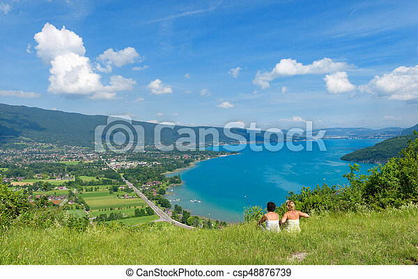 Two women watching view of Lake Annecy - csp48876739
