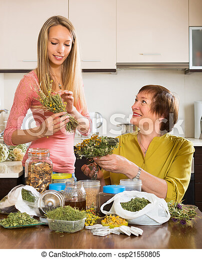 Two women with dried herbs - csp21550805