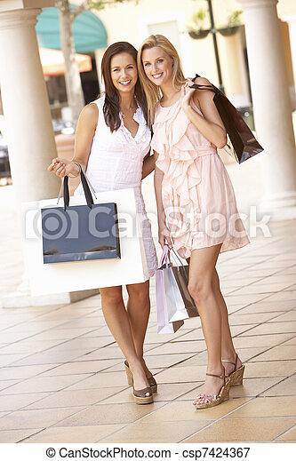 Two Young Women Enjoying Shopping Trip Together - csp7424367