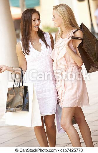 Two Young Women Enjoying Shopping Trip Together - csp7425770