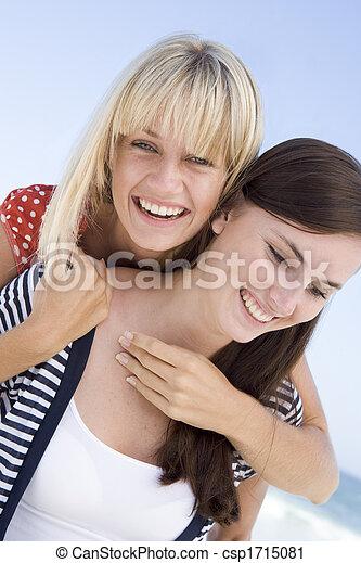 Two young women posing outdoors - csp1715081