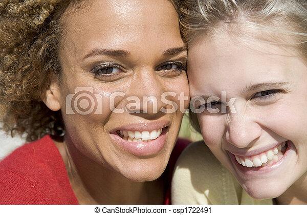 Two young women posing outdoors - csp1722491