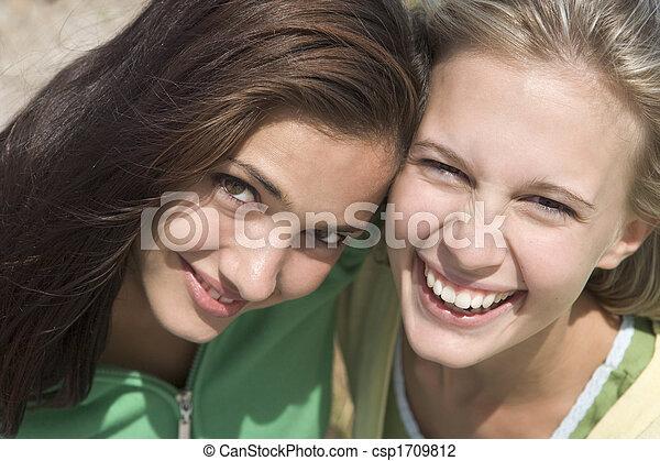 Two young women posing outdoors - csp1709812