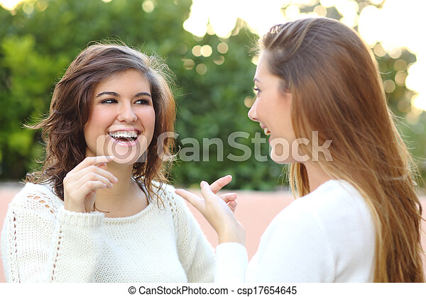 Two young women talking outdoor - csp17654645