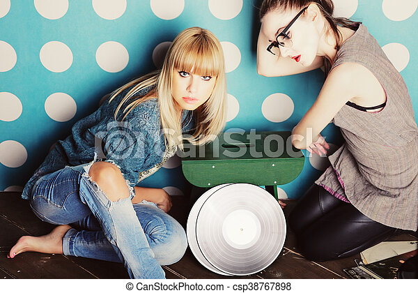 Two young women with vinyl records - csp38767898