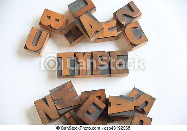 Type word with assorted wood letters - csp43192368