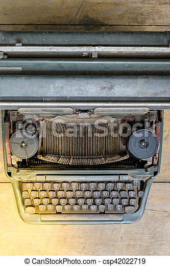 Typewriter on wood - csp42022719