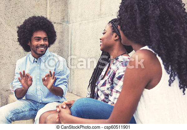 Typical african american man with two women - csp60511901