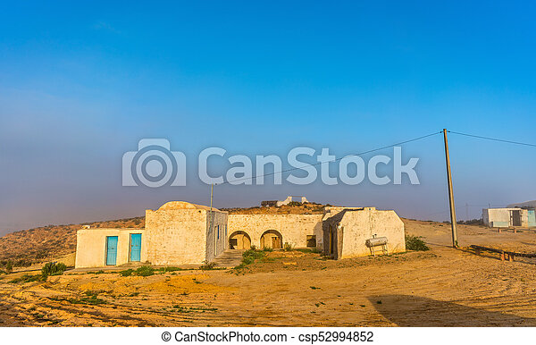 Typical berber house in the Tunisian countryside at Tataouine - csp52994852