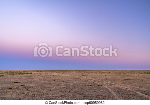 typical clear sky after sunset over Colorado prairie - csp60959982