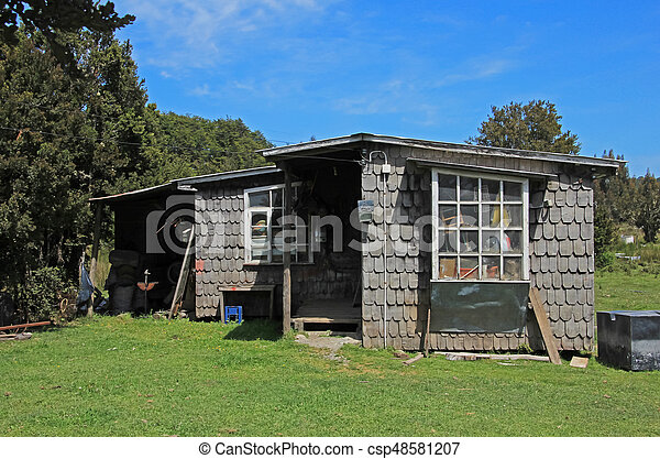 Typical wooden house on Chiloe Island, Chile - csp48581207