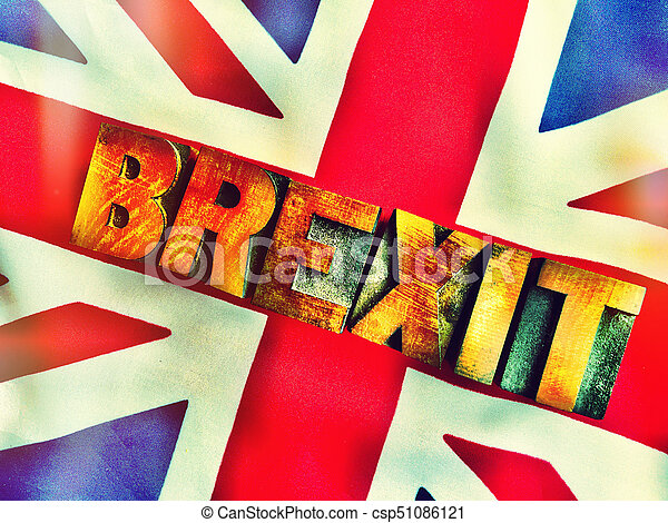 UK flag with Brexit word in wood type filtered - csp51086121