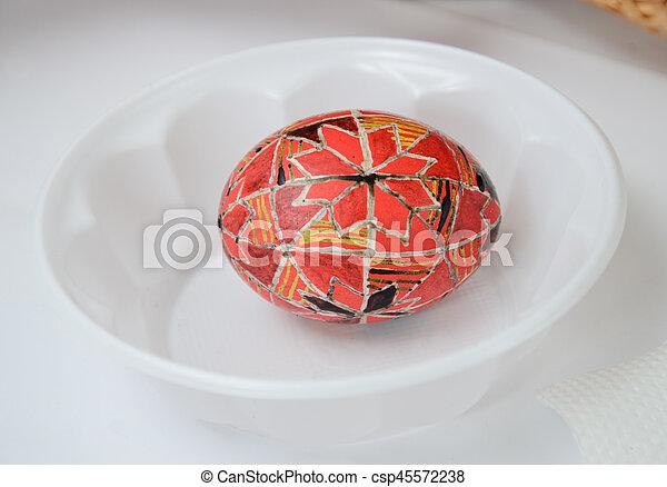 Ukrainian pisanka covered with wax - csp45572238