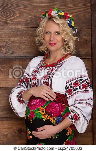 Ukrainian pregnant woman in vyshyvanka - csp24785603
