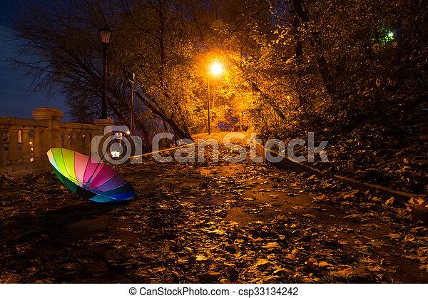 Umbrella in the night autumn park - csp33134242