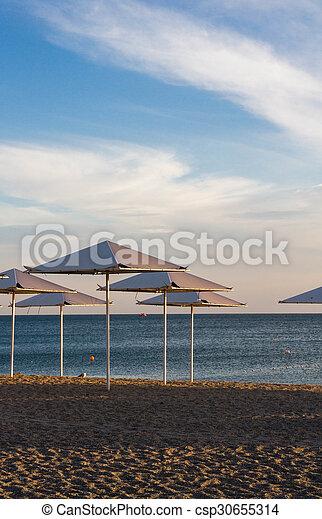 Umbrellas on the beach on the black sea - csp30655314