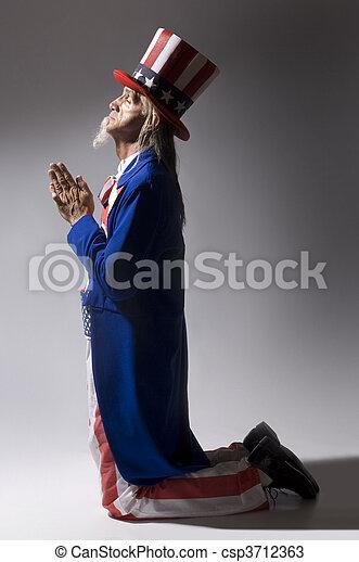 Uncle Sam in Prayer - csp3712363